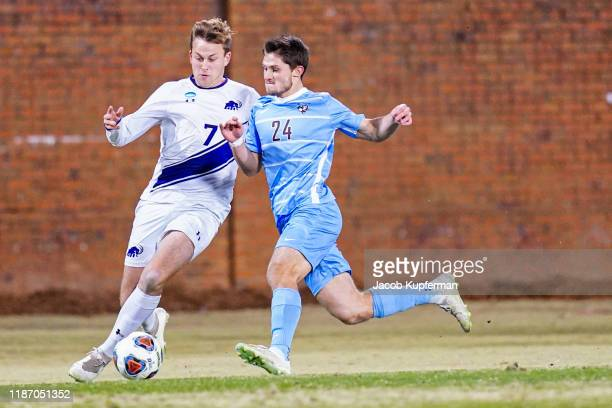 Dane Lind of Amherst Mammoths and Drew Stern of Tufts Jumbos fight for the ball during the Division III Men's Soccer Championship held at UNCG Soccer...