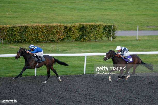 Dane O'Neill riding Mushahadaat win The 32Redcom/British Stallion Studs EBF Maiden Fillies' Stakes at Kempton Park racecourse on October 4 2017 in...