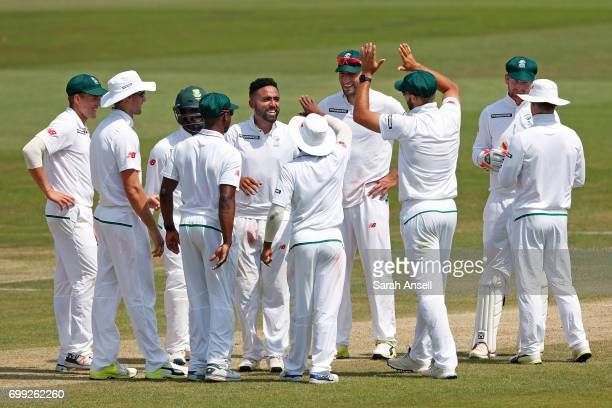 Dane Piedt of South Africa A celebrates with teammates after taking the wicket of Nick Gubbins of the England Lions during day 1 of the match between...