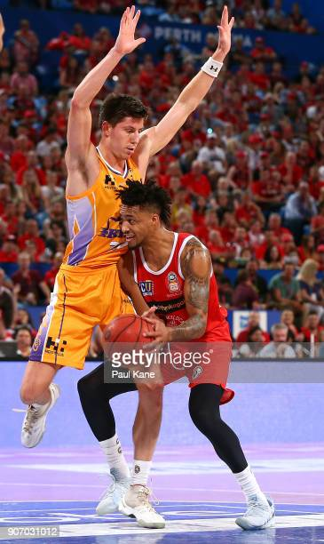 Dane Pineau of the Kings presses up on JeanPierre Tokoto of the Wildcats during the round 15 NBL match between the Perth Wildcats and the Sydney...