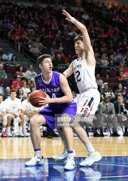 Dane Pineau of the Saint Mary's Gaels guards Gabe Taylor of the Portland Pilots during a quarterfinal game of the West Coast Conference Basketball...