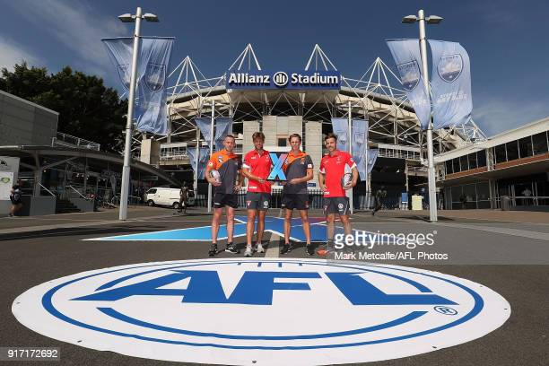 Dane Rampe and Jake Lloyd of the Sydney Swans and Tom Scully and Lachie Whitfield of GWS Giants pose with the AFLX trophy during the Sydney AFLX...