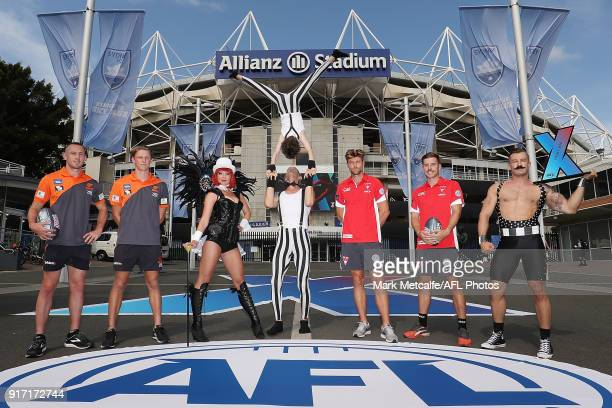 Dane Rampe and Jake Lloyd of the Sydney Swans and Tom Scully and Lachie Whitfield of GWS Giants pose with performers during the Sydney AFLX launch at...