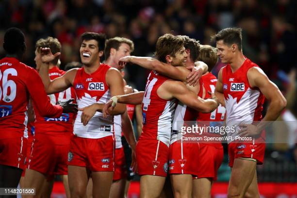 Dane Rampe of the Swans and team mates celebrate winning the round eight AFL match between the Sydney Swans and the Essendon Bombers at Sydney...