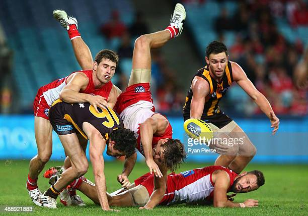 Dane Rampe of the Swans crashes through the pack during the round eight AFL match between the Sydney Swans and the Hawthorn Hawks at ANZ Stadium on...