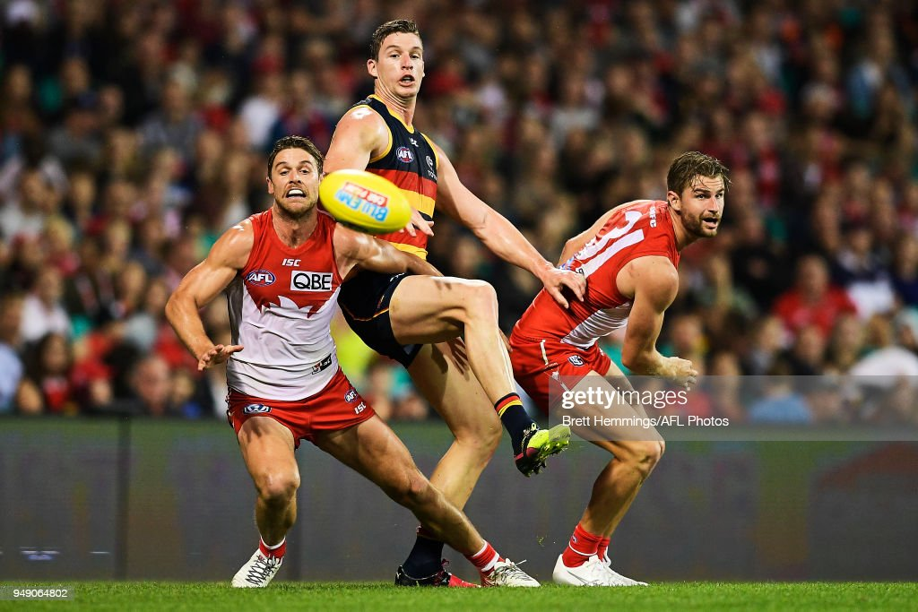 Dane Rampe of the Swans, Harry Marsh of the Swans and Josh Jenkins of the Crows contest the ball during the round five AFL match between the Sydney Swans and the Adelaide Crows at Sydney Cricket Ground on April 20, 2018 in Sydney, Australia.