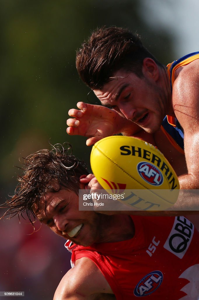 Dane Rampe of the Swans is tackled by Daniel McStay of the Lions during the AFL JLT Community Series match between the Brisbane Lions and the Sydney Swans at Moreton Bay Central Sports Complex on March 3, 2018 in Brisbane, Australia.