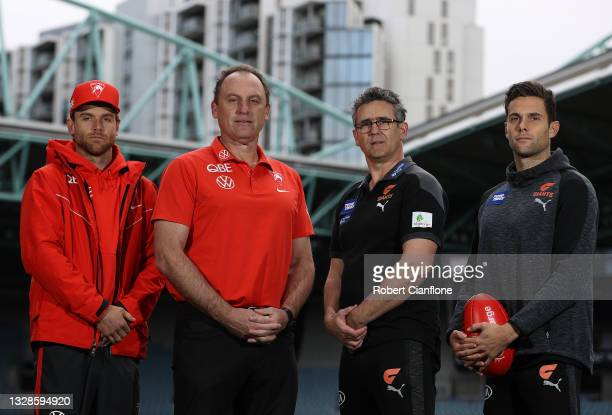 Dane Rampe of the Swans, Swans coach John Longmire, Giants coach Leon Cameron and Josh Kelly of the Giants pose during a Sydney Swans and Greater...