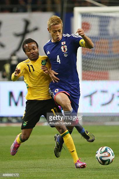 Dane Richards of Jamaica and Keisuke Honda of Japan competes for the ball during the international friendly match between Japan and Jamaica at Denka...