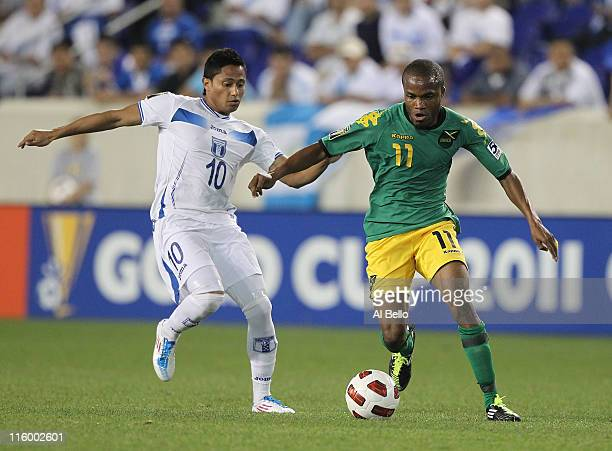 Dane Richards of Jamaica battles Ramon Nunez of Honduras during the Concaf Gold Cup at Red Bull Arena on June 13 2011 in Harrison New Jersey