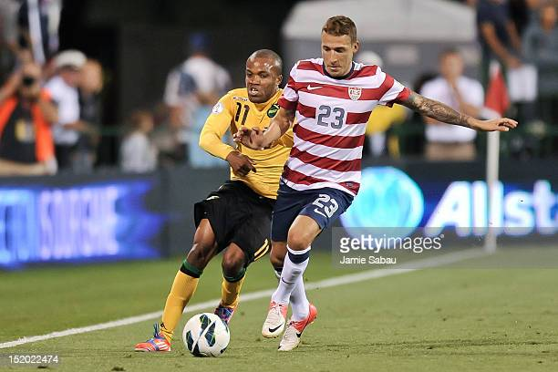 Dane Richards of the Jamaican National Team and Fabian Johnson of the US National Team battle for control of the ball on September 11 2012 at Crew...