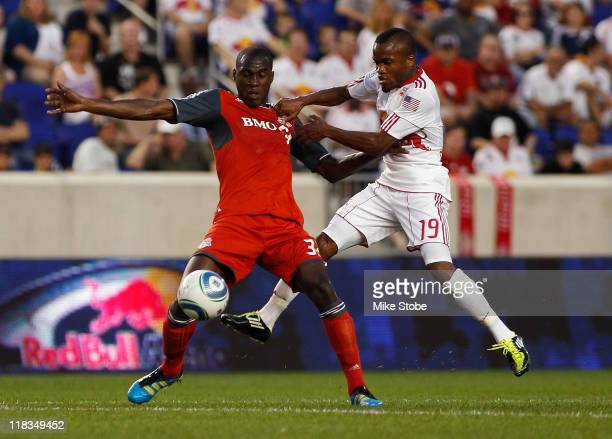 Dane Richards of the New York Red Bulls challenges Tony Tchani of Toronto FC for the ball on July 6 2011 at Red Bull Arena in Harrison New Jersey Red...