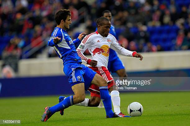 Dane Richards of the New York Red Bulls is challengedy by Josh Gardner of the Montreal Impact at Red Bull Arena on March 31 2012 in Harrison New...
