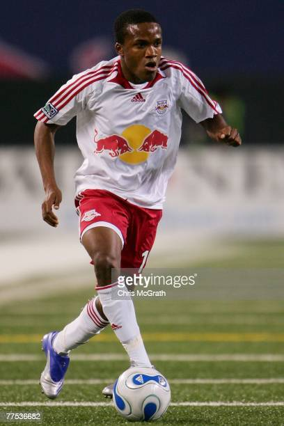 Dane Richards of the New York Red Bulls runs with the ball against the New England Revolution during their Eastern Conference Semifinal match at...
