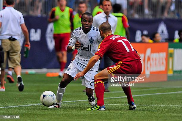 Dane Richards of the Vancouver Whitecaps brings the ball up field while being closely defended by Chris Wingert of Real Salt Lake at BC Place on...