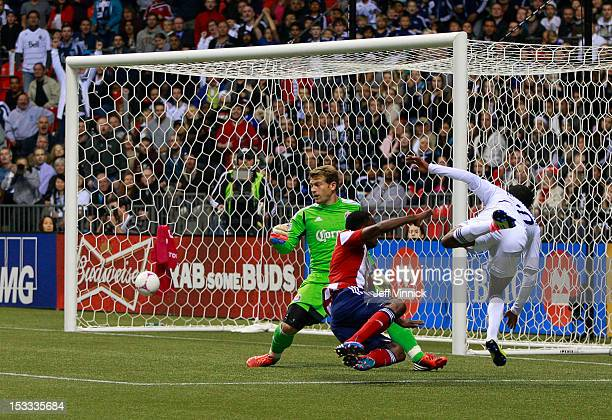 Dane Richards of the Vancouver Whitecaps FC beats John Valencia and Dan Kennedy of Chivas USA for a goal during their MLS game October 3 2012 at BC...