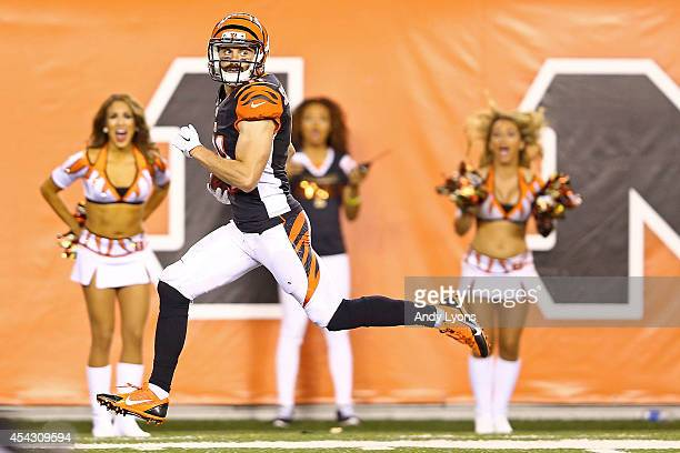 Dane Sanzenbacher of the Cincinnati Bengals returns a punt for a touchdown during the third quarter against the Indianapolis Colts at Paul Brown...
