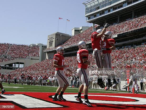 Dane Sanzenbacher of the Ohio State Buckeyes celebrates a first quarter touchdown with Brian Hartline Rory Nicol and Todd Boeckman against the...
