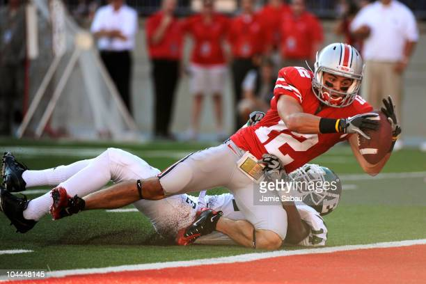 Dane Sanzenbacher of the Ohio State Buckeyes leans in to score his third touchdown of the first half against the Eastern Michigan Eagles at Ohio...