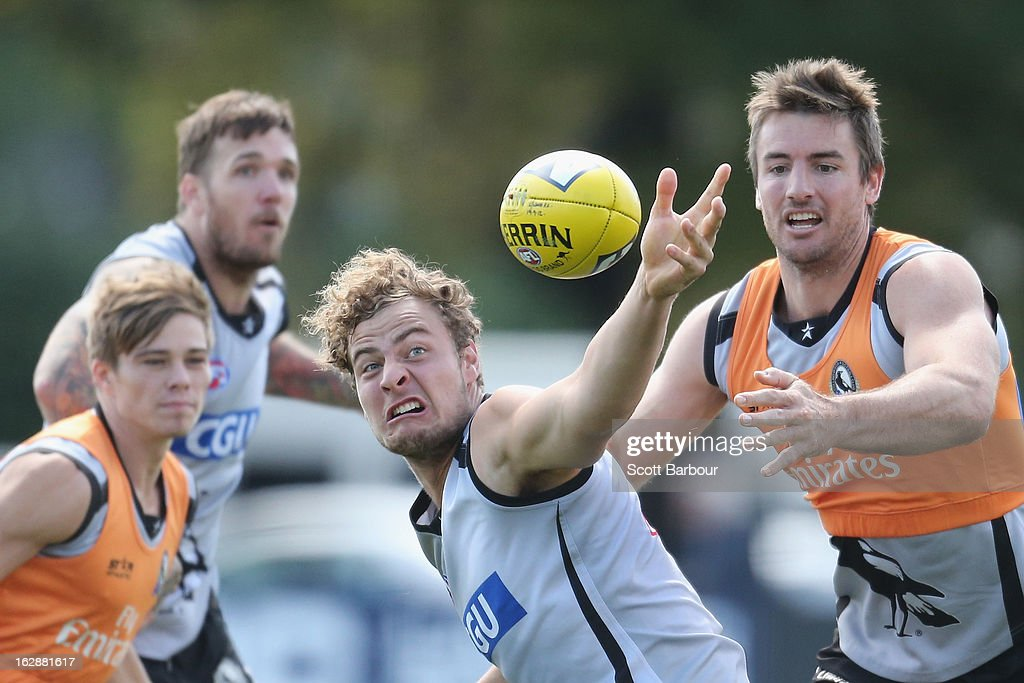 Dane Swan, Jarrod Witts and Darren Jolly of the Magpies compete for the ball during a Collingwood Magpies AFL training session at Gosch's Paddock on March 1, 2013 in Melbourne, Australia.