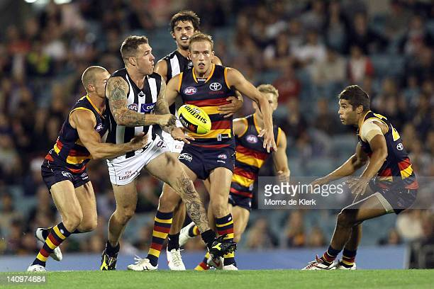 Dane Swan of the Magpies passes the ball during the round three NAB Cup match between the Adelaide Crows and the Collingwood Magpies at AAMI Stadium...