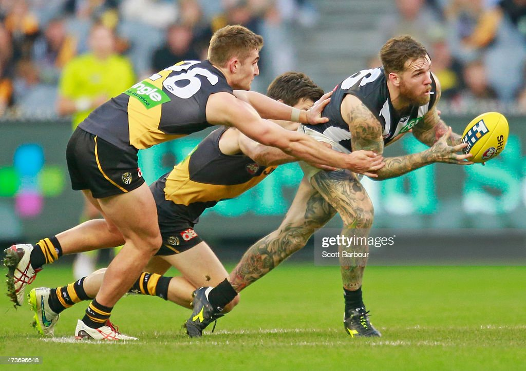Dane Swan of the Magpies passes the ball in a tackle during the round seven AFL match between the Richmond Tigers and the Collingwood Magpies at the Melbourne Cricket Ground on May 17, 2015 in Melbourne, Australia.