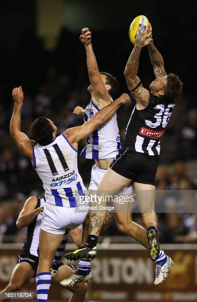 Dane Swan of the Magpies takes a high mark during the round one AFL match between the North Melbourne Kangaroos and Collingwood Magpies at Etihad...