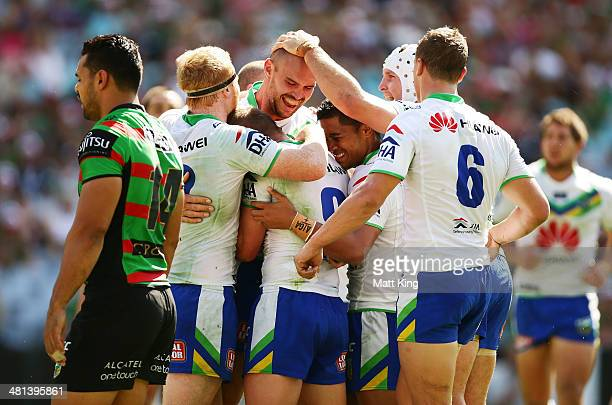 Dane Tilse of the Raiders celebrates with team mates after scoring a try during the round four NRL match between the South Sydney Rabbitohs and the...