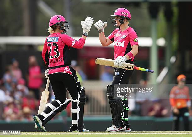 Dane van Niekerk and Sarah Aley of the Sixers celebrate after hitting the winning runs during the Women's Big Bash League match between the Sydney...