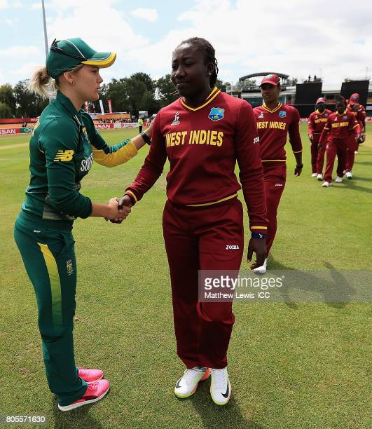 Dane van Niekerk Captain of South Africa consoles Stafanie Taylor Captain of West Indies after her team defeated the West Indies during the ICC...