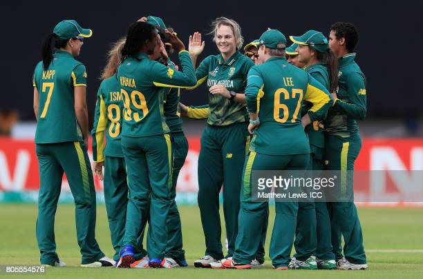 Dane van Niekerk of South Africa is congratulated on the wicket of Shanel Daley of the West Indies after she was caught by Laura Wolvaardt during the...