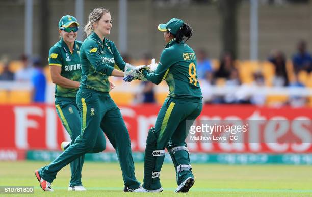 Dane van Niekerk of South Africa is congratulated on the wicket of Shikha Pandey of India after she was stumped by Trisha Chetty during the ICC...
