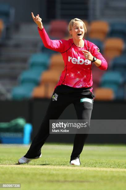 Dane Van Niekerk of the Sixers celebrates after taking a hattrick during the Women's Big Bash League match between the Hobart Hurricanes and the...