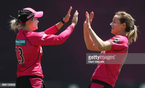 Dane Van Niekerk of the Sixers celebrates with Ellyse Perry of the Sixers after taking a catch to dismiss Rachel Haynes of the Thunder during the...