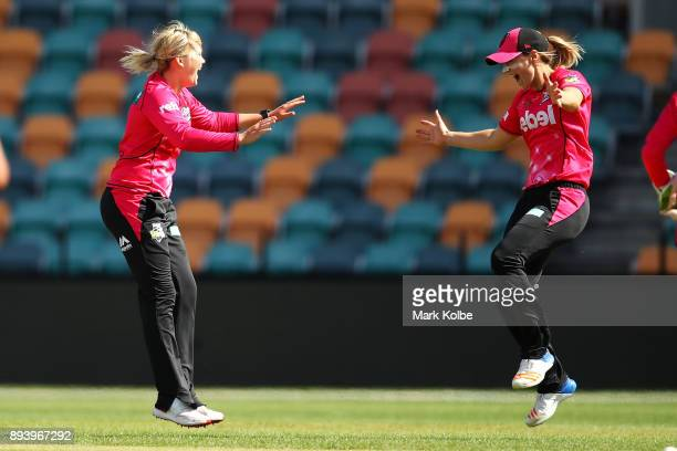 Dane Van Niekerk of the Sixers celebrates with Ellyse Perry of the Sixers after taking a hattrick during the Women's Big Bash League match between...