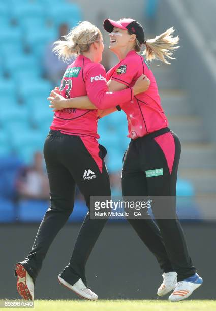 Dane Van Niekerk of the Sixers celebrates with Ellyse Perry of the Sixers after taking the wicket of Stefanie Daffara of the Hurricanes for a hat...