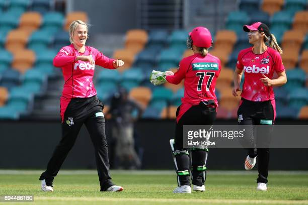 Dane Van Niekerk of the Sixers celebrates with her team after taking the wicket of Corinne Hall of the Hurricanes during the Women's Big Bash League...