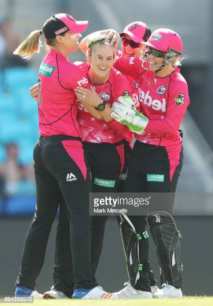 Dane Van Niekerk of the Sixers celebrates with team mates after taking the wicket of Stefanie Daffara of the Hurricanes for a hat trick during the...