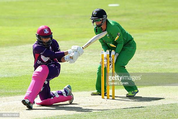 Dane van Nierkerk of Loughborough Lighting is bowled by Stafanie Taylor of Western Storm during the Kia Super League Finals Day at The Essex County...