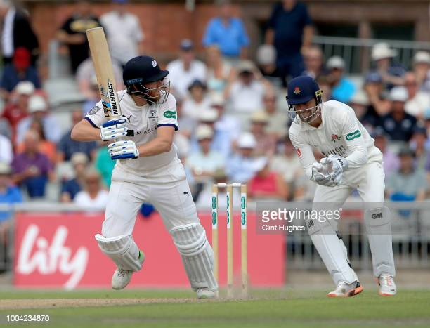 Dane Vilas of Lancashire looks on as Jonny Bairstow of Yorkshire bats during day two of the Specsavers County Championship division one match between...