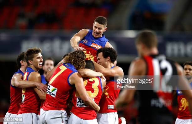 Dane Zorko of the Lions celebrates after Connor Ballenden of the Lions kicked his first AFL goal during the round nine AFL match between the Essendon...