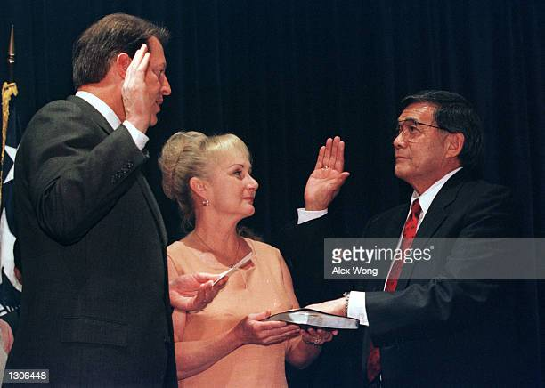 Danealia Deni Mineta middle holds the Bible as her husband Norman Mineta right is sworn in by Vice President Al Gore as Secretary of Commerce July 25...