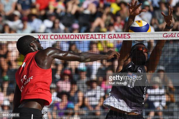 Daneil Williams of Trinidad and Tobago competes during the Beach Volleyball Men's Preliminary round against Inia Korowale and Sairusi Cavula of Fiji...