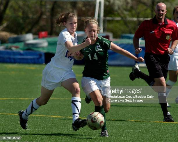 Daneille Birdsall left Broomfield High School fights for control for the ball with Autumn Ball Fossil Ridge High School during the state playoff game...