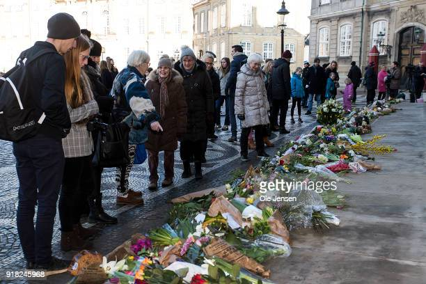 Danes and tourists lay flowers at the stairs to Amalienborg Palace in memory of Prince Henrik husband to Queen Margrethe who died yesterday evening...