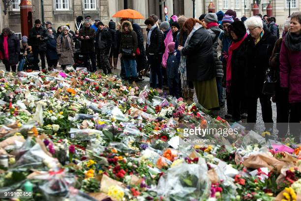 Danes and tourists lay flowers at the stairs to Amalienborg Palace in memory of Prince Henrik of Denmark, husband to Queen Margrethe, on February 16,...