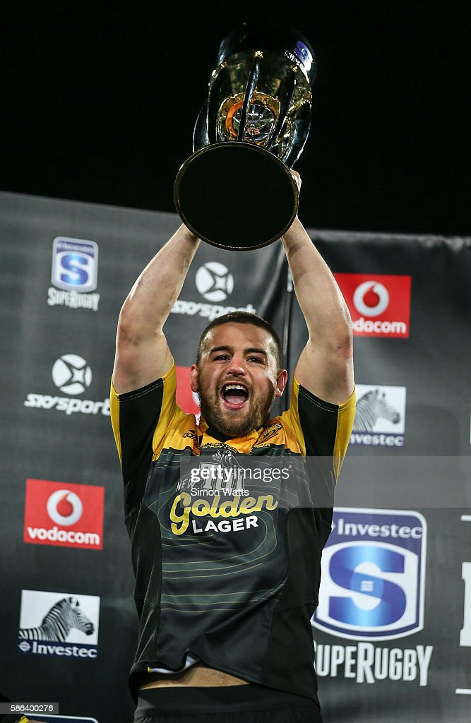 Danes Coles of the Hurricanes hoists the Super Rugby Trophy after the Hurricanes won the 2016 Super Rugby Final match between the Hurricanes and the Lions at Westpac Stadium on August 6, 2016 in Wellington, New Zealand.