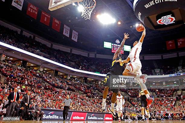 DÕAngelo Russell of the Ohio State Buckeyes attempts to shoot the ball against the defense of Anthony Clemmons of the Iowa Hawkeyes during the second...