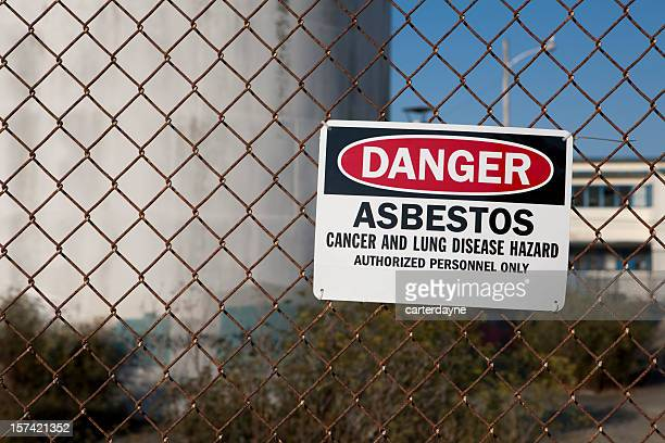 danger asbestos warning sign - asbestos stock pictures, royalty-free photos & images