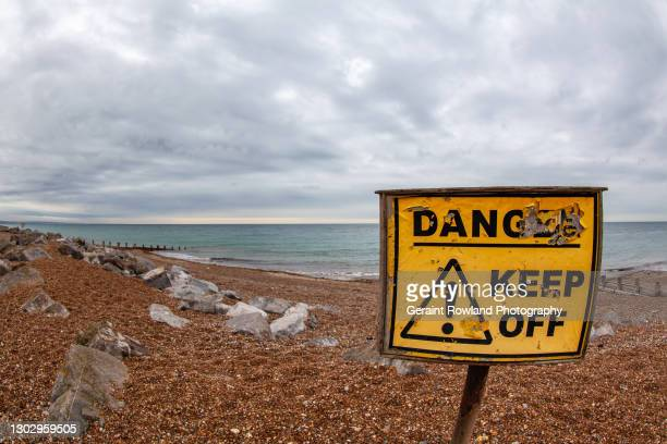 danger beach, england - sign stock pictures, royalty-free photos & images